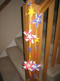 4th of July Garland on Stairs grandma lizzies house